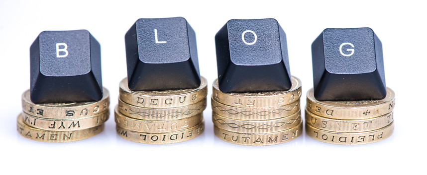 Pound Coins and Keyboard Keys spelling BLOG