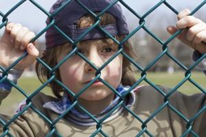 Boy behind wire