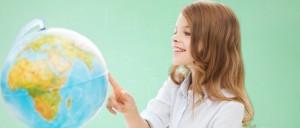 female geography student studying globe