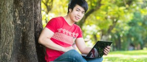 Econmics Student studying in the park