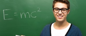 Physics student standing in front of E=mc2