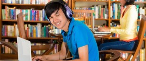 Spanish A level Student listening to audio in library
