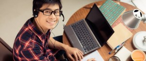 Student using a computer to Listen to Spanish